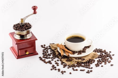 Foto op Canvas Cafe Coffee grinder winch and Coffee cup with beans on hemp sack