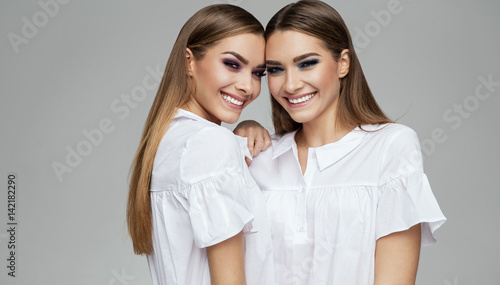 Natural smile of sisters models Canvas Print