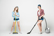 Women with cleaning appliances