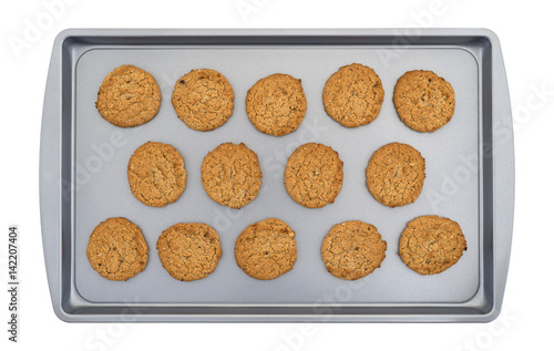 Valokuva Top view of oatmeal cookies on a baking sheet isolated on a white background