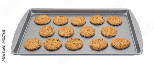Valokuva  Oatmeal cookies on a baking sheet isolated on a white background.