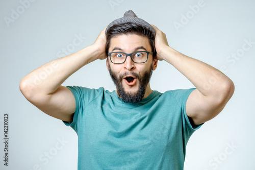 Man with shocked, amazed expression Fototapete