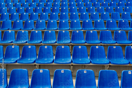 Foto  Dark blue rows of seats on the stadium