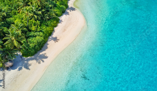 Aerial photo of tropical Maldives beach on island