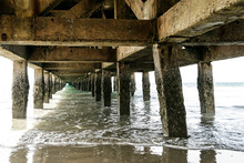 View Of Sea Under The Old Pier