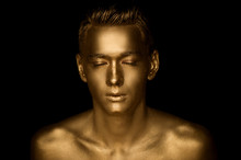 A Handsome Man Of Athletic Build, Completely Covered In Gold Paint.Studio Photos
