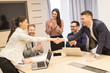 Business partners analyze the business results in modern office