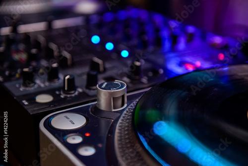 Close up Professional DJ audio equipment - turntable vinyl record player, selective focus Wallpaper Mural