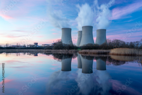 Fotografiet  Nuclear power plant with dusk landscape.
