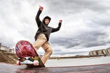 Teen Skater In A Hoodie Sweats...