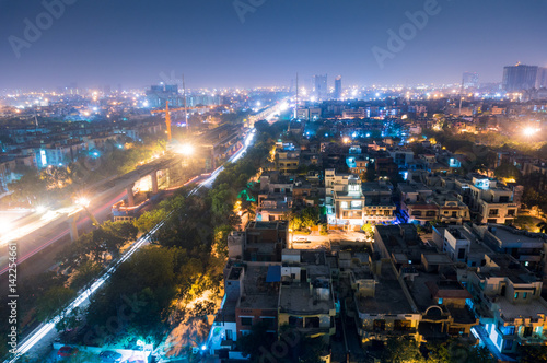 Fotografie, Obraz  Cityscape of Noida Delhi at night with lights and under construction buildings
