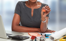 African-American Realtor Woman With Key.