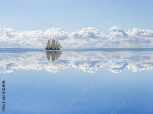 Fotografie, Obraz  Sailboat sails into the calm in the sea bay.