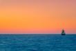 Leinwanddruck Bild - Cargo ship sailing during colorful sunset, Crete, Greece.