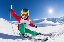 Little Skier Having Fun At Sunny Snowy Day