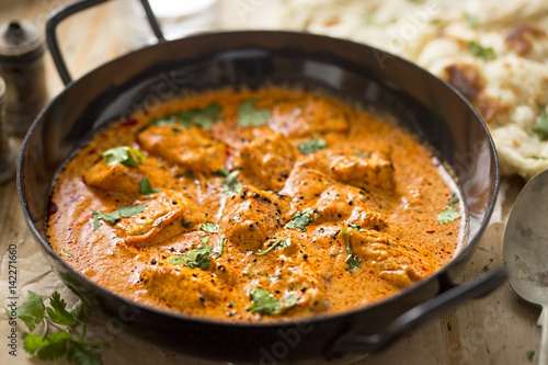 Tuinposter Kip Butter chicken curry with tender chicken breast, cream, butter & honey