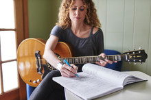 A Woman With A Guitar, Writing...
