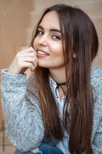 Closeup Portrait Of Smiling Caucasian Brunette Young