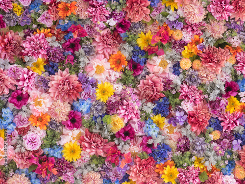 Cadres-photo bureau Fleuriste Multi-colored flower wall background