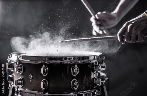 man plays musical percussion instrument with sticks, a musical concept, beautifu Fototapeta