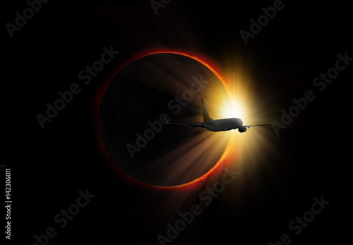 """Aircraft crossing the Solar Eclipse """"Elements of this image furnished by NASA """""""