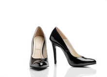 Pair Of Black Classic Women's High-Heeled Shoes Isolated On A White Background