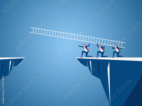 Business team using ladder to cross through the gap between hill Canvas