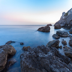Obraz na Plexi Minimalistyczny Beautiful seascape. Sea and rock at the sunset. Nature composition. Long exposure photography.