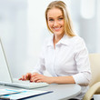 Young business woman using computer at office