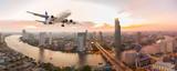Fototapeta Miasto - Airplane take off over the panorama city at sunset