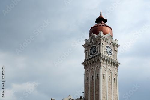 Clock tower of Sultan Abdul Samad building facade in Kuala Lumpur, Malaysia Poster