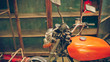 Antique rusty grunge orange motorcycle.