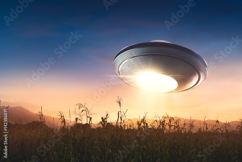 Garden Poster UFO UFO with abduction beam flying in the sky