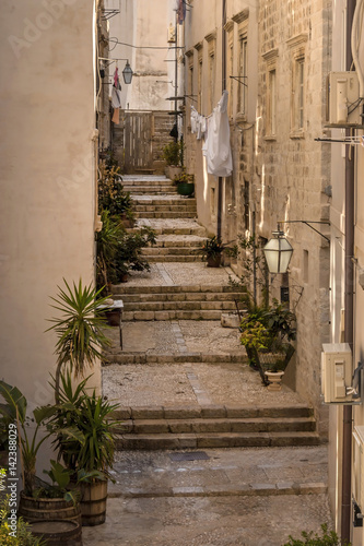 Narrow street with stairs in Old Town Dubrovnik Poster