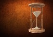 Egg Timer with sand against brown background