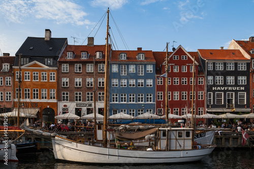 COPENHAGEN, DENMARK - 26 JUNE, 2016: People are relaxing in small canal with col Canvas Print