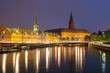 Night view on Christiansborg Palace and Stock Exchange building over the channel in Copenhagen.