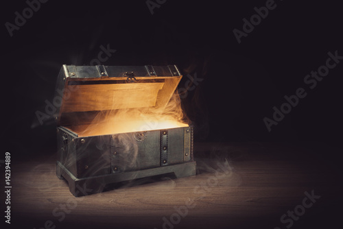 open pandoras box with smoke on a wooden background