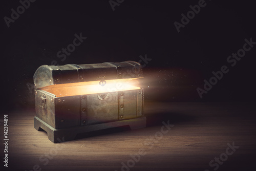 open pandora's box with smoke on a wooden background