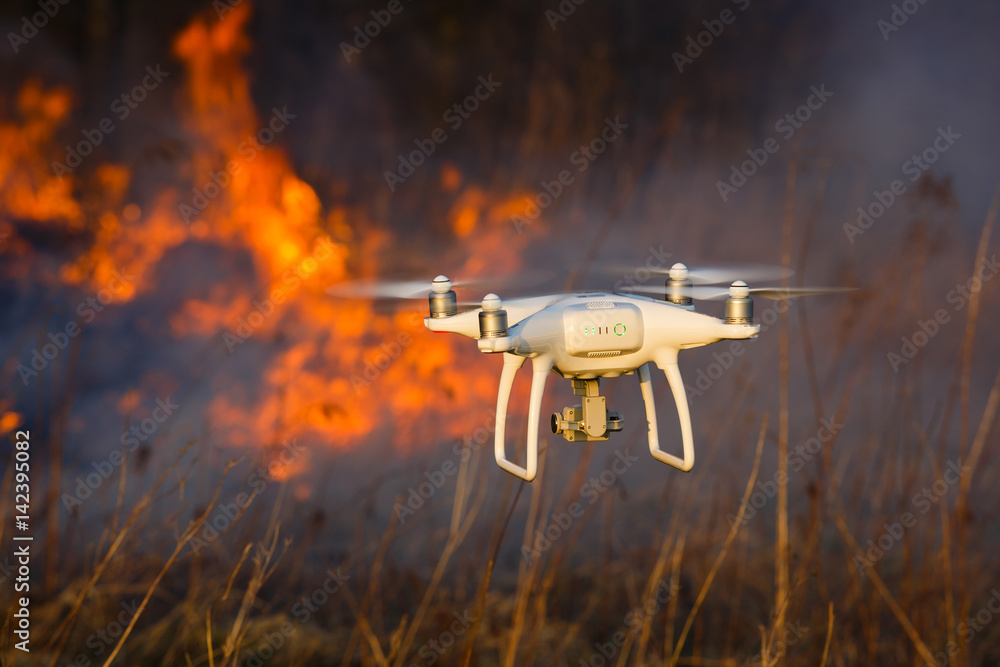 Fototapety, obrazy: Flying drone in a fire