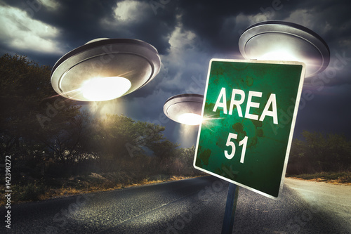 Tuinposter UFO Area 51 sign on a road with dramatic lighting