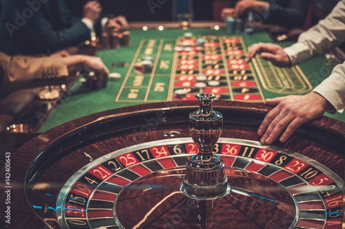 Gambling table in luxury casino Fototapeta