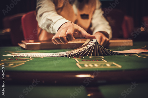 Croupier behind gambling table in a casino Fotobehang