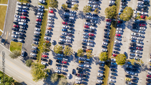 Aerial overhead view of big and crowded car parking