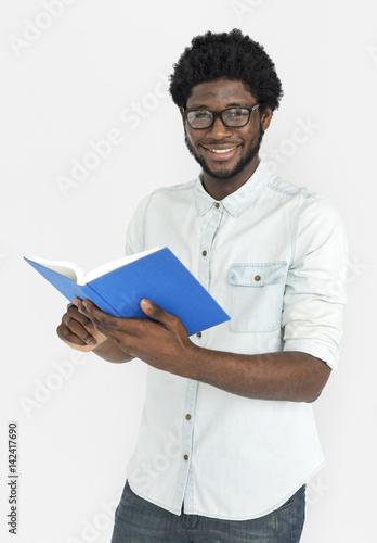 Obraz na plátne African Descent Holding Book Concept