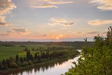 Sunburst Setting Above Red Deer River