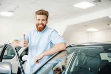 Happy Young Man Leaning At New Car And Showing Thumb Up