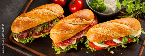 Poster de jardin Snack Trio of three fresh sandwiches