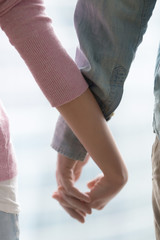 Close up of couple holding hands, female and male hands together, expressing happy relationships, family support, travelling together, loving couple, romantic feelings, sharing love, good and bad