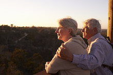 Senior Couple Watching Sunset ...